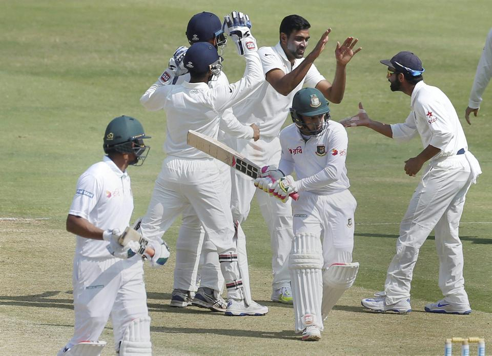 India cricket team's Ravichandran Ashwin celebrates his 250th Test wicket with teammates after dismissing Bangladesh cricket team skipper Mushfiqur Rahim.