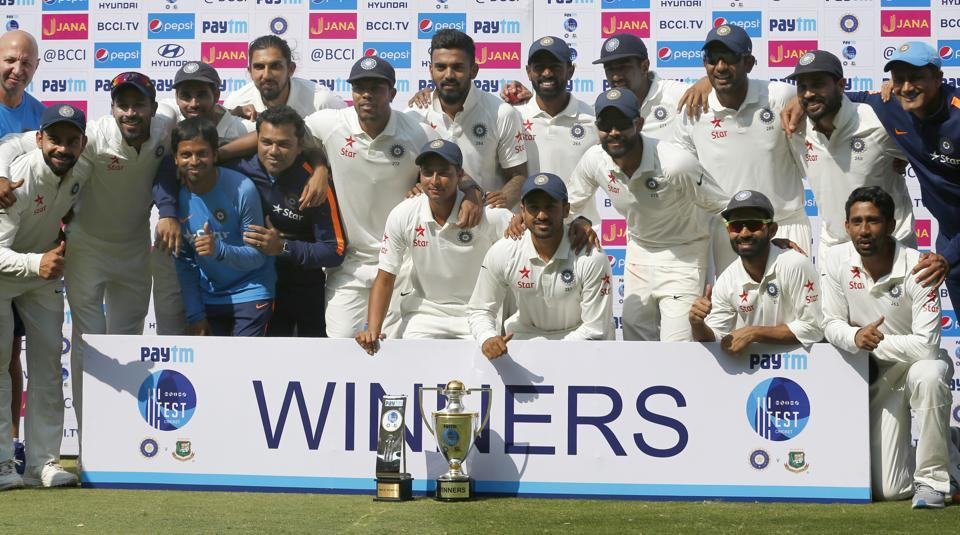 India cricket team pose with the trophy after their win over Bangladesh in their one-off cricket test match in Hyderabad. (AP)