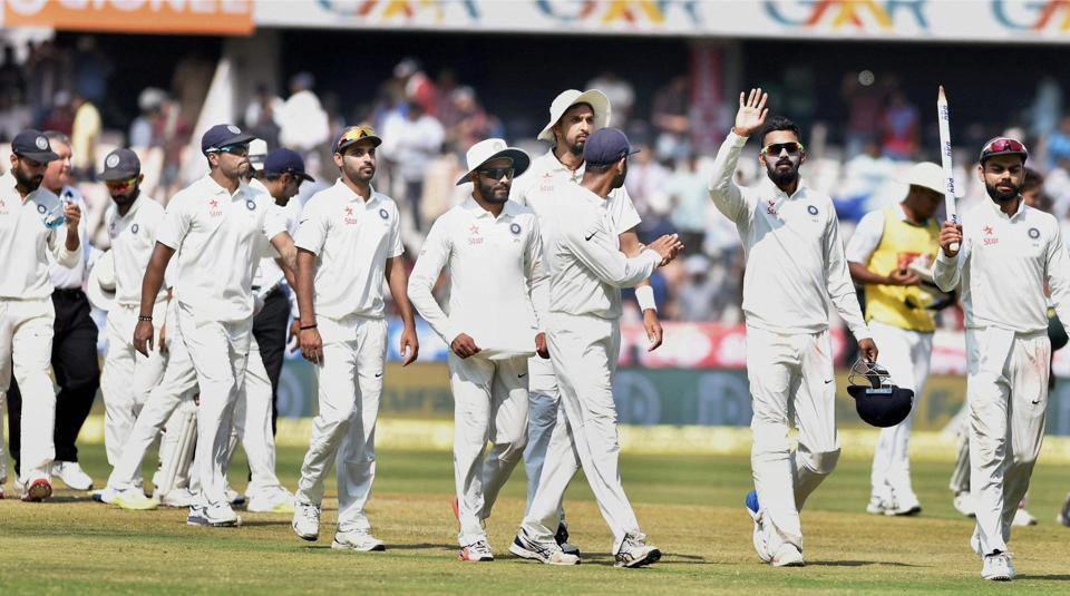 Indian skipper Virat Kohli with teammates after defeating Bangladesh in the one-off Test in Hyderabad.