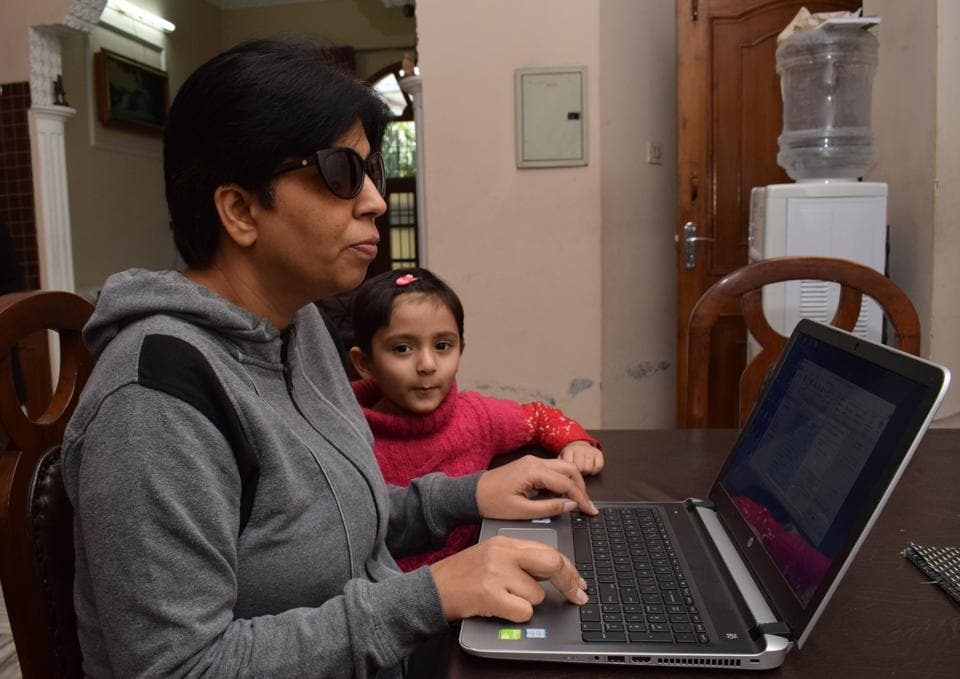 Visually-impaired Deepika Sood teaching her daughter at her residence in Jalandhar on Sunday.
