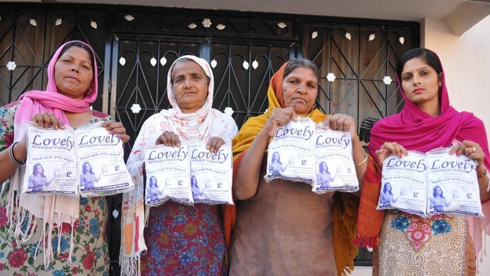 Members of a self-help group showing the detergent powder — Lovely — at Bajuha Khurad village in Jalandhar on Sunday.