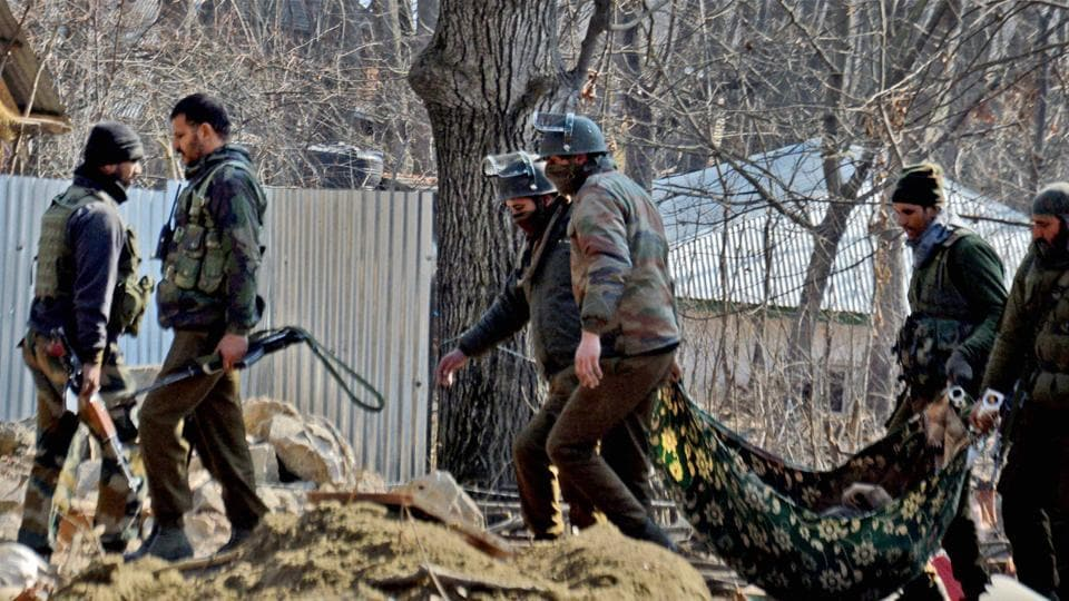 The Special Operation Group of Jammu and Kashmir police carrying the body of a militant which was recovered from the rubble of a destroyed house where militants were hiding during an encounter at Frisal area of Kulgam district of South Kashmir on Sunday.