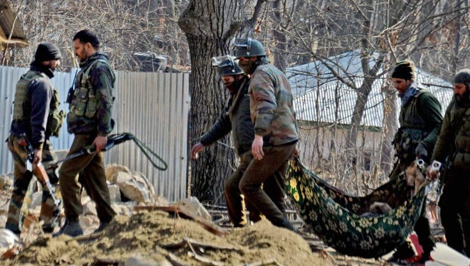 Special Operation Group (SOG) of Jammu and Kashmir police carry the body of a militant recovered from the rubbles of destroyed house where militants were hiding during an encounter at Frisal area of Kulgam district of South Kashmir on Sunday.