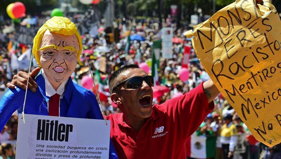 Thousands take part in an anti-Trump march in Mexico City, on February 12, 2017. Mexicans took to the streets against US President Donald Trump, hitting back at his anti-Mexican rhetoric and vows to make the country pay for his