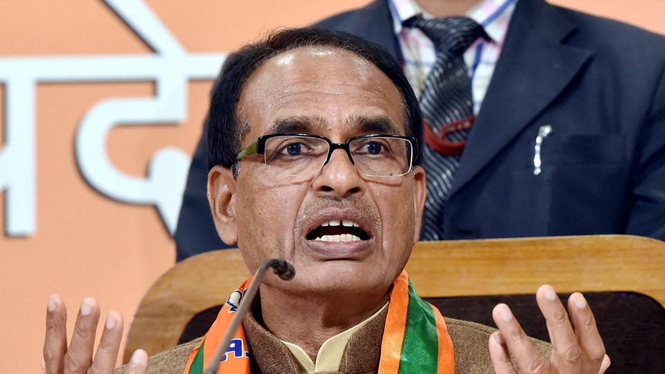 Madhya Pradesh Chief Minister and BJP leader Shivraj Singh Chouhan addresses a press conference at party headquarters in Lucknow on Monday.