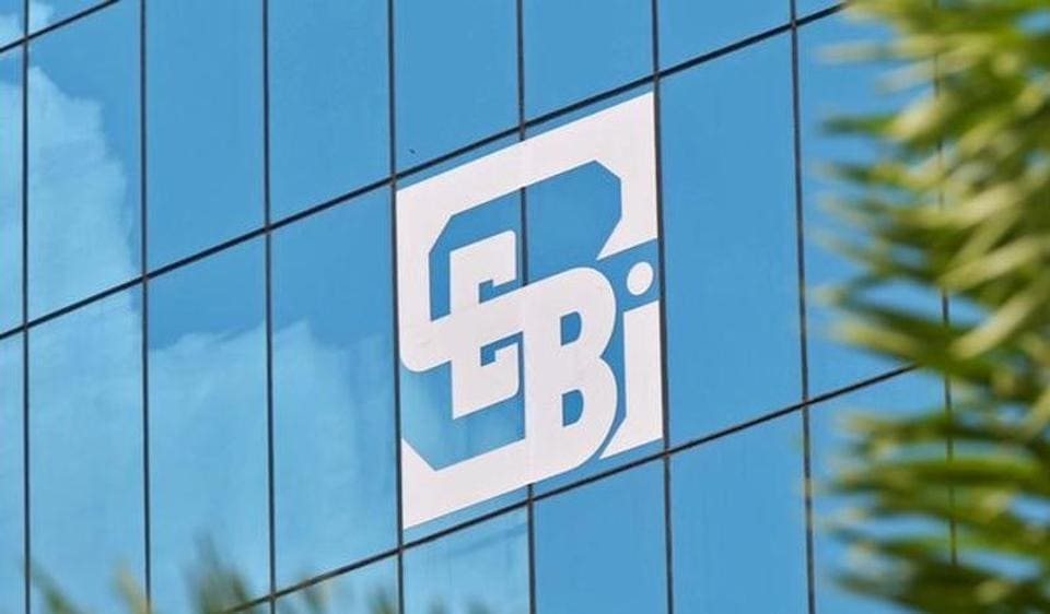 The logo of the Securities and Exchange Board of India (SEBI), India's market regulator, is seen on the facade of its head office building in Mumbai.