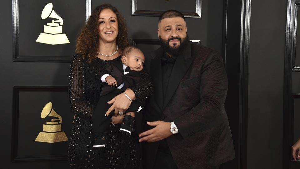 From left: Nicole Tuck, Asahd Tuck Khaled, and DJ Khaled arrive at the awards cremony.  (AP)