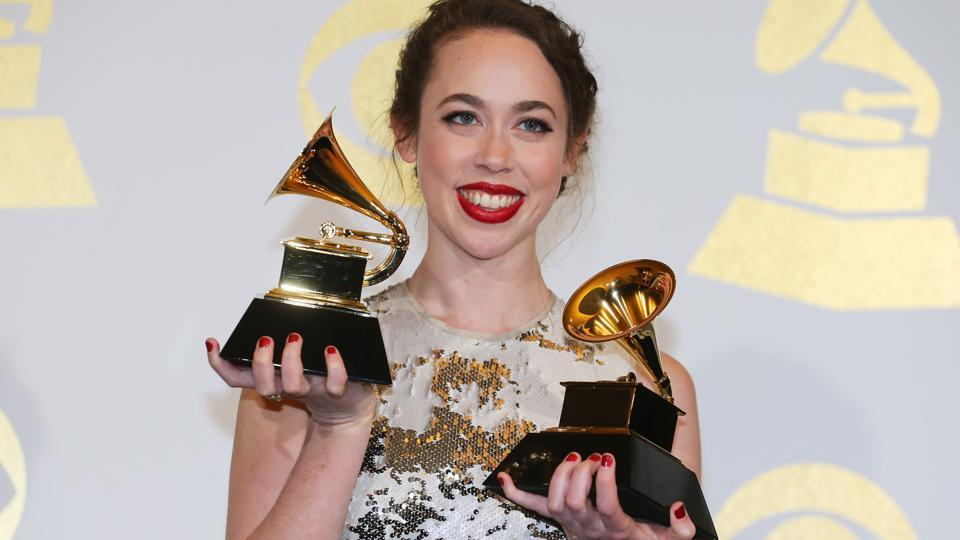 Sarah Jarosz holds her awards for Best Folk Album and Best American Roots Performance. (REUTERS)