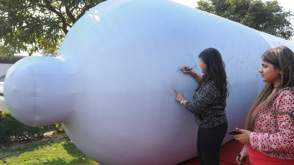 "As a part of the ""Always in Fashion"" event, a 40-feet inflatable CONDOM shaped balloon was installed at Central Park. People were encouraged to sign on it to endorse condom use.  (Burhaan Kinu/HT Photo)"