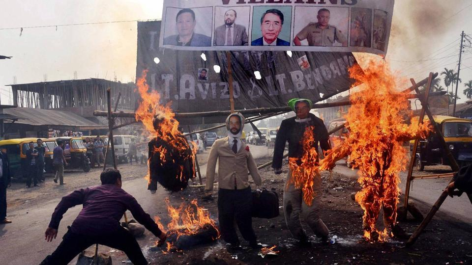 Protesters burn effigy of Nagaland chief minister TR Zeliang, home minister Y Patton, NPF president Shürhozelie and Nagaland IRB personnel during a protest against killing of two youth by security personnel last month in Dimapur.