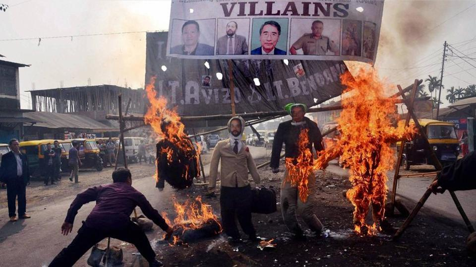 Protesters burn effigies of Nagaland chief minister TR Zeliang, and other ministers during a protest against the killing of two youth in January.