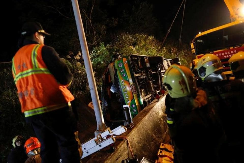 Rescuers gather around a crashed bus in Taipei, Taiwan, on  Monday.