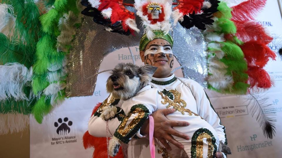 Miguel Garcia with his dog dressed in the fashion of Mexico participate in the World Fashion Presents segment during the 14th Annual New York Pet Fashion Show (TIMOTHY A. CLARY / AFP)