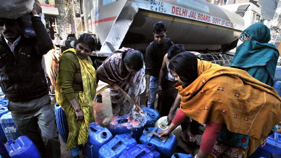 New Delhi, India - Feb. 23, 2016: Residents with their empty containers crowd around a municipal tanker to fetch water in New Delhi, India, on Tuesday, February 23, 2016. (Photo by Sanchit Khanna/ Hindustan Times)
