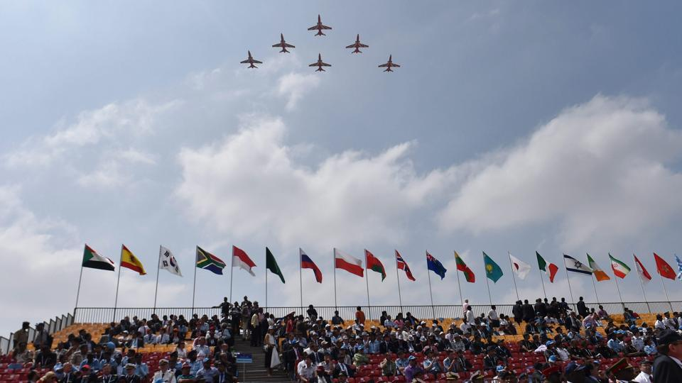 Indian Air Force's aerobatic team performs during the inauguration of the 11th biennial edition of Aero India 2017 at Yelahanka Air base in Bengaluru on Tuesday.