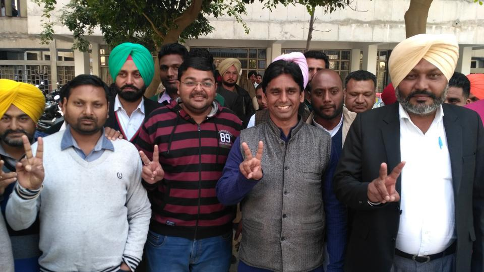 AAP's Mehrauli MLA Naresh Yadav (right) coming out of a court in Sangrur on Monday.
