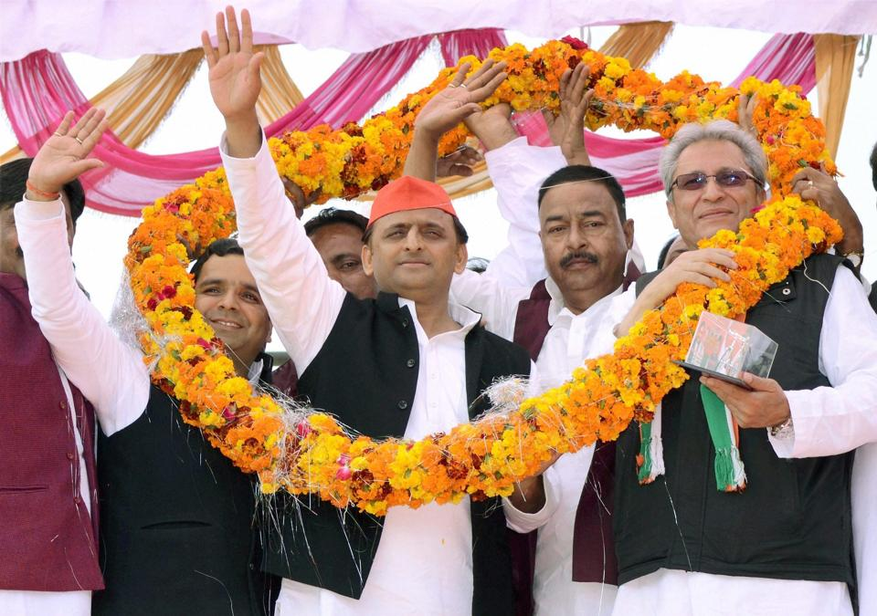 UP chief minister Akhilesh Yadav waves to Samajwadi Party supporters at an election rally in Badaun on Monday.