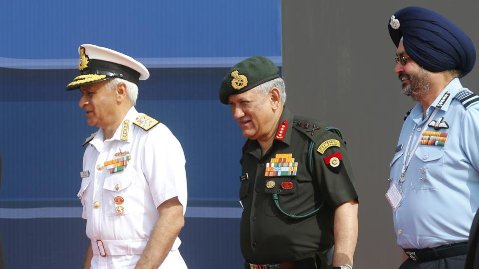 Indian Army Chief Bipin Rawat (centre), Air Force Chief Birender Singh Dhanoa (right), and Navy Chief Sunil Lanba arrive at the opening ceremony of Aero India 2017. Aero India is a biennial event with flying demonstrations by stunt teams and militaries and commercial pavilions where aviation companies display their products and technology.   (AP)