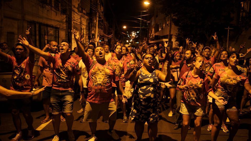 Revellers of Estacio de Sa samba school rehearse on a street in Rio de Janeiro, Brazil, on February 13, 2017.