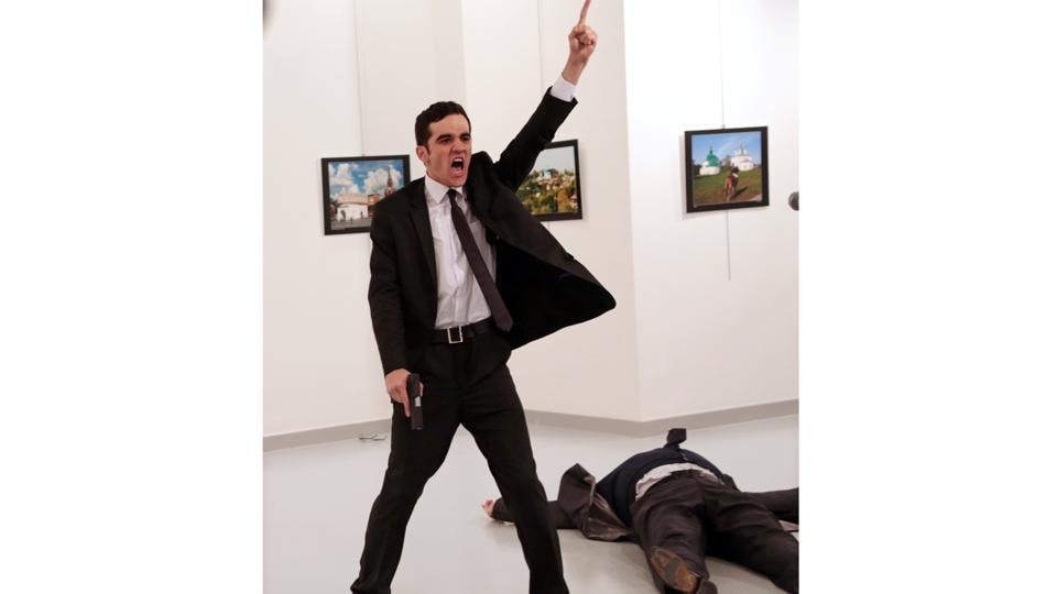 Spot News, first prize, stories: Mevlut Mert Altintas shouts after shooting Russian ambassador to Turkey Andrei Karlov, at an art gallery in Ankara, Turkey on December 19, 2016.  (Burhan Ozbilici/AP Photo)