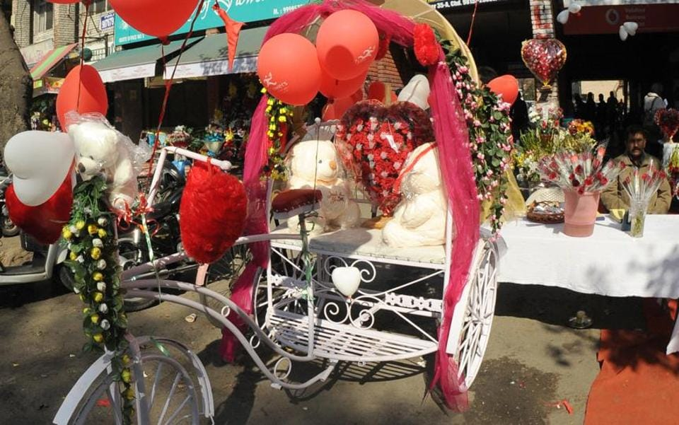 A florist with a decorated rickshaw on the Valintine's Day eve in Sector 35,Chandigarh, on Monday.
