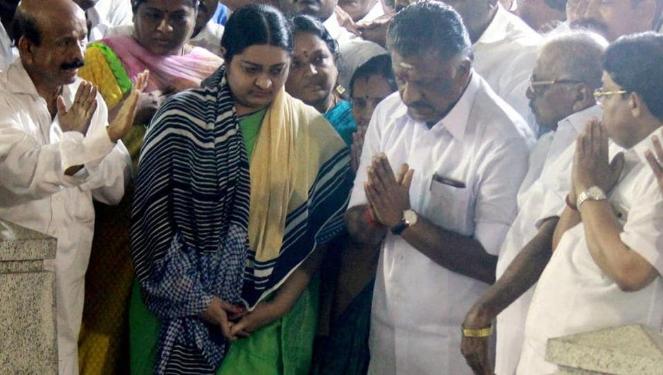 Deepa Jayakumar, former Tamil Nadu chief minister J Jayalalithaa's niece with O Panneerselvam and MLAs pray at the grave of J Jayalalithaa in Chennai on Tuesday.