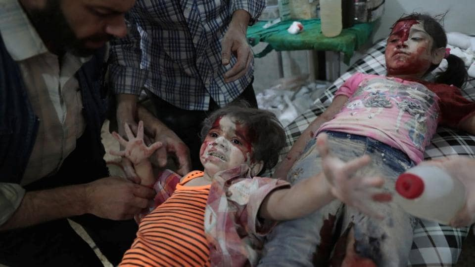 Second prize in the Spot News category: A Syrian girl cries out as a wounded child lies next to her at a makeshift hospital on in September, 2016. (Abd Doumany)