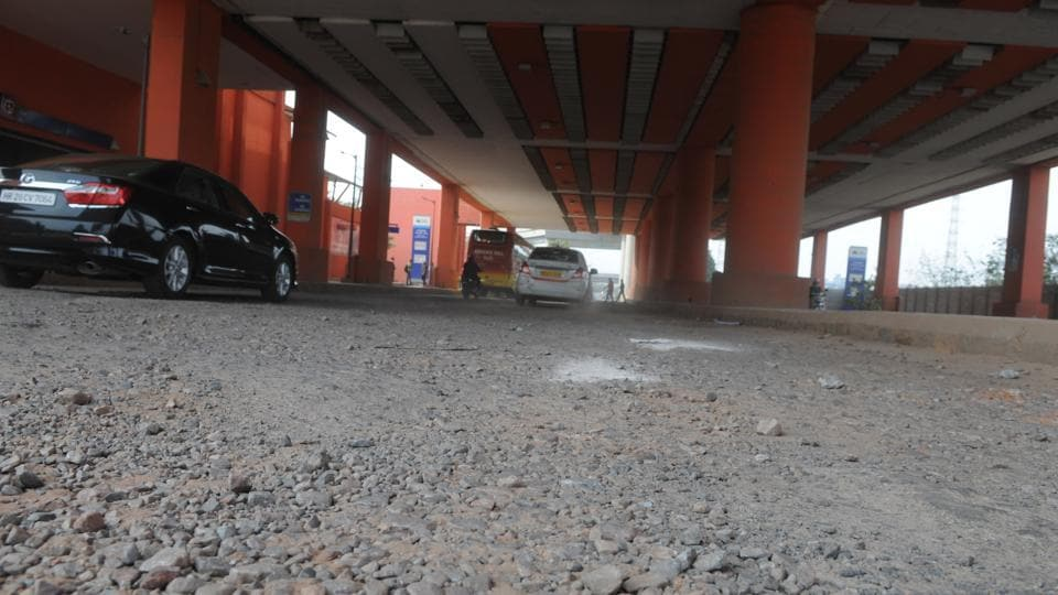 A 200-metre patch of a circular road in DLF Cyber City near the Moulsari Avenue Metro station is riddled with potholes, causing problems for commuters moving towards the NH-8.