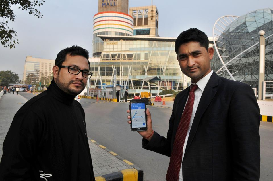 Yogesh Ojha (right), manager of Ninkasi, uses Google Maps to check the motor able distance from the highway to his establishment in DT Star Mall, Sector 30, Gurgaon, on Tuesday.