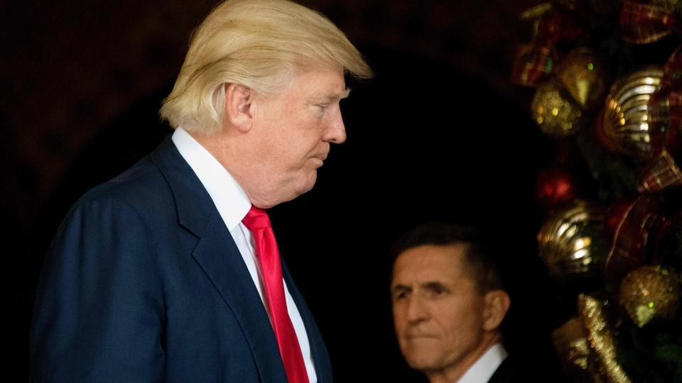 File photo of US President Donald Trump  with National Security Adviser Michael Flynn at Mar-a-Lago in Palm Beach, Florida, in December 2016.