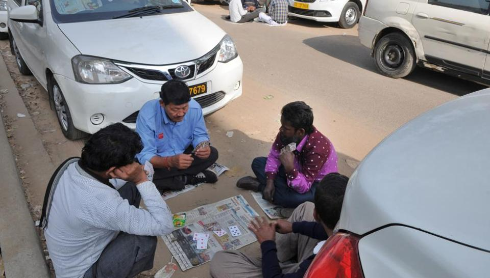 Cab drivers play cards during the sixth day of strike. The availability of cabs, however, was better on Tuesday.