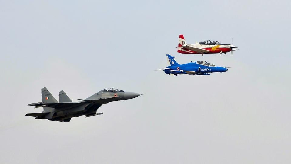 IAF planes perform during the inauguration of Aero India show at the Yelahanka Air Force Station in Bengaluru on Tuesday.  (Abhishek N. Chinnappa / REUTERS)