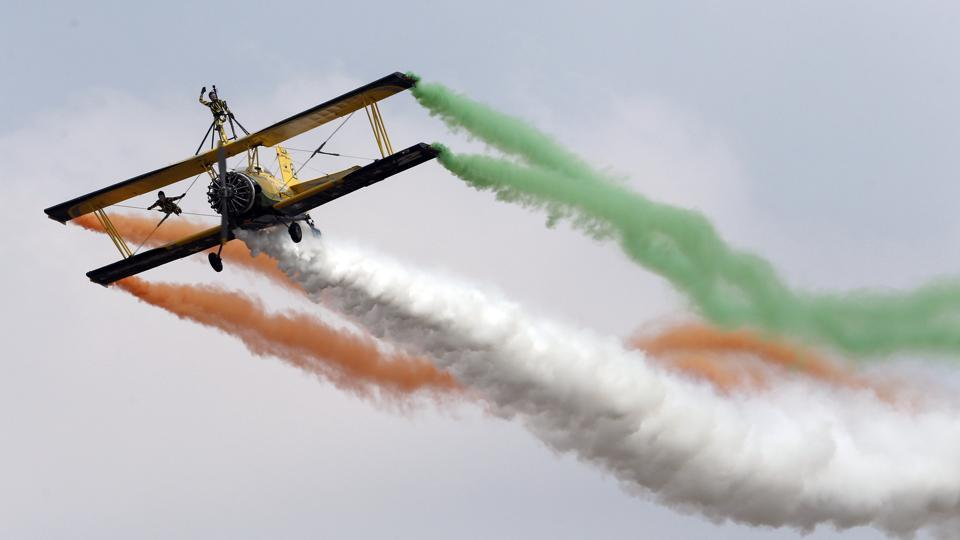 The Skycat Wingwalkers' from the Scandinavian Airshow aerobatic team perform at the opening ceremony of Aero India 2017 at Yelahanka air base in Bangalore on Tuesday. Aero India is a biennial event with flying demonstrations by stunt teams and militaries and commercial pavilions where aviation companies display their products and technology. (AP)