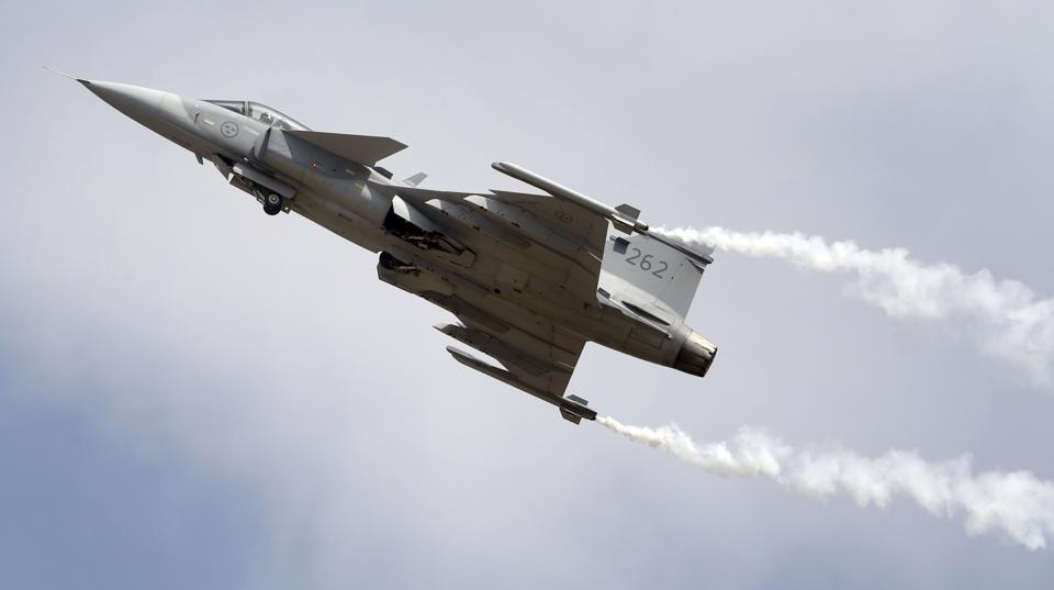 Gripen, a Swedish fighter aircraft, performs at the opening ceremony.   (AP)