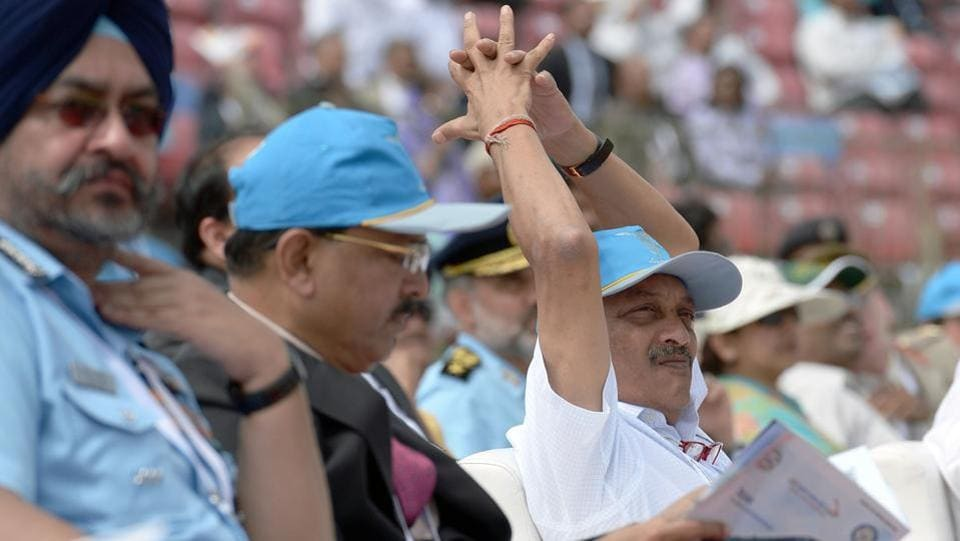 (Right to left ) Indian defense minister Manohar Parrikar, National Security Advisor Ajit Doval, and Air Chief Marshal of the Indian Airforce Birender Singh Dhanoa watch the Surya Kirans aerobatic team of the Indian Air Force during an aerial display over the skies of Yelahanka Air Force Station. (AFP)