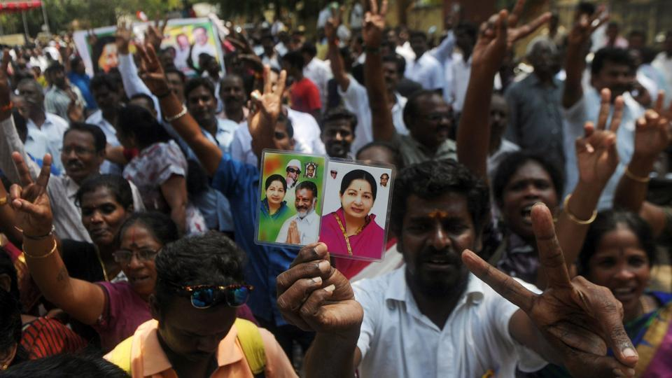AIADMK supporters celebrate in front of acting chief minister O Panneerselvam's residence in Chennai on Tuesday.