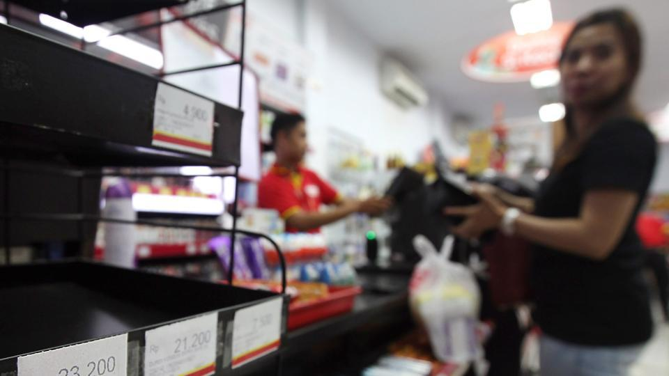 A condom rack is left empty at a convenience store in Makassar, South Sulawesi province, in Indonesia on Valentine's day. Indonesian authorities raided convenience stores and seized condoms in a major city to stop teenagers having casual sex on the day.