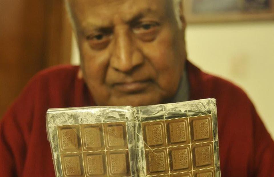 Industrialist Raj Paul Oswal displaying his chocolate stamp.