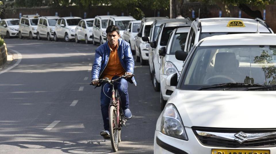 Ola Uber taxis seen at Jantar Mantar in New Delhi, India, on Tuesday, February 14, 2017.