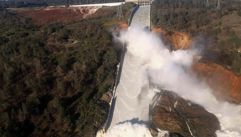 A damaged spillway with eroded hillside is seen in an aerial photo taken over the Oroville Dam in Oroville, California, US.