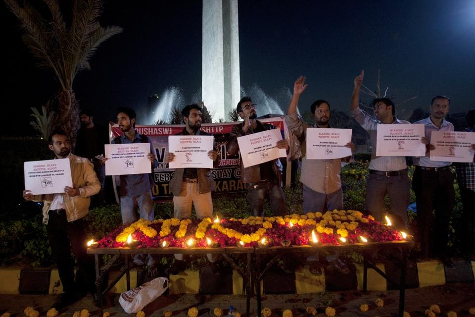 Karachi residents on Tuesday hold a candlelight vigil for the victims of the Lahore blast.