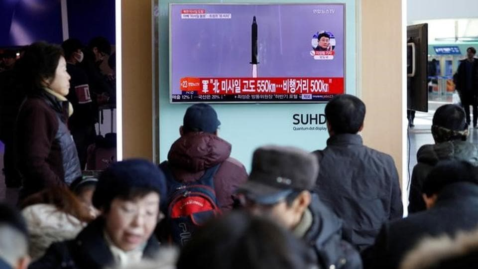 Passengers watch a TV screen broadcasting a news report on North Korea firing a ballistic missile into the sea off its east coast, at a railway station in Seoul, South Korea, February 12, 2017.
