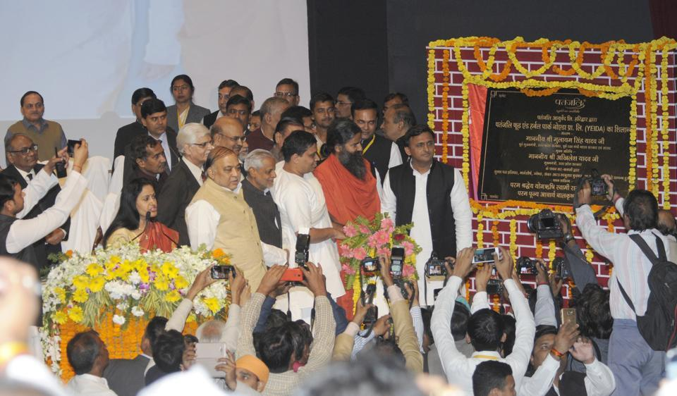 UP chief minister Akhilesh Yadav, Baba Ramdev and Acharya Balkrishna lay the foundation stone of Patanjali Yogpeeth Food Park and University in Lucknow in November 2016.
