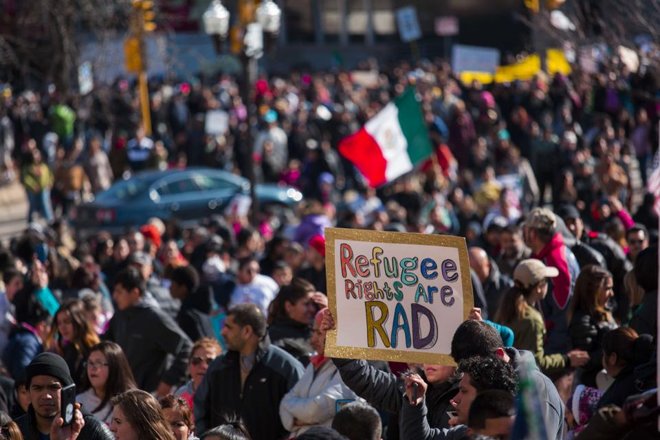 Protestors gather at the Milwaukee County Courthouse where they held a rally against President Donald Trumps policy on immigration February 13, 2017.