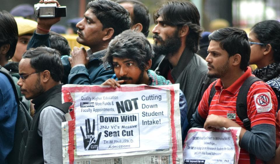 JNU students and teachers hold placards during a protest on Tuesday against seat cut. The protest march  taken out from Mandi House to Jantar Mantar.