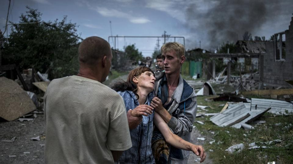 Long Term Project, first prize: Citizens in the village of Luhanskaya after an air strike.  (Valery Melnikov, Rossiya Segodnya )