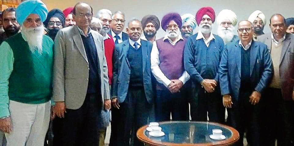 Members of the Punjabi University Re-employed Professors Association holding a meeting on the university campus in Patiala on Wednesday.