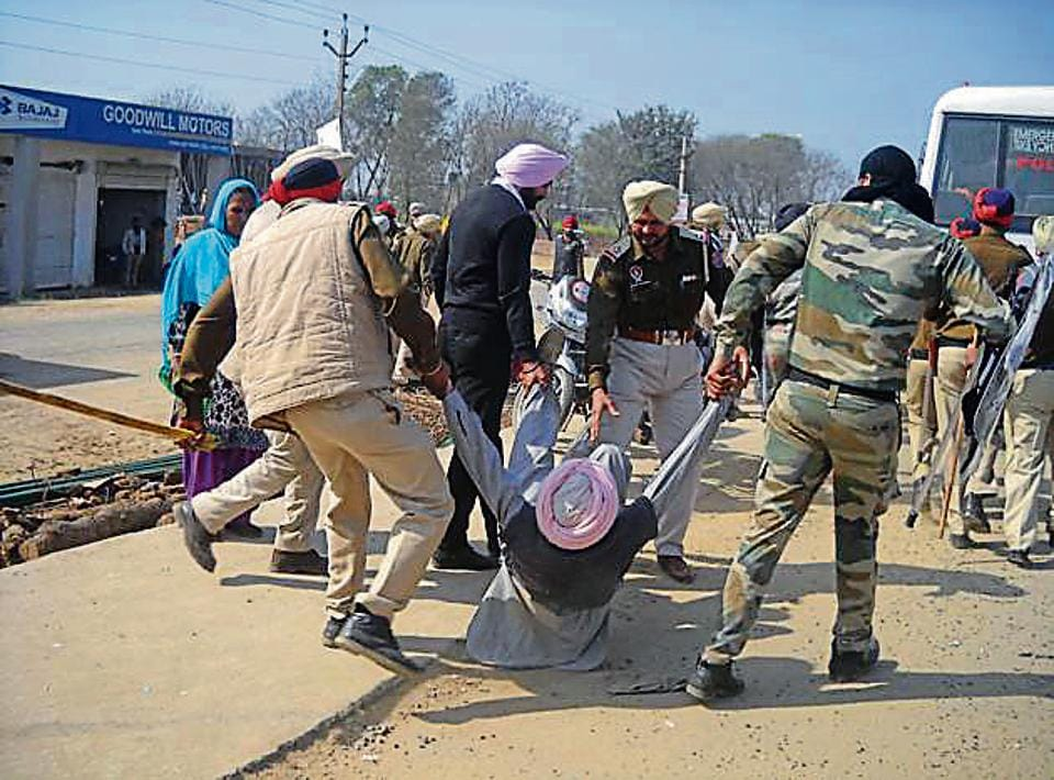 Police lifting a protester in Moga on Wednesday.