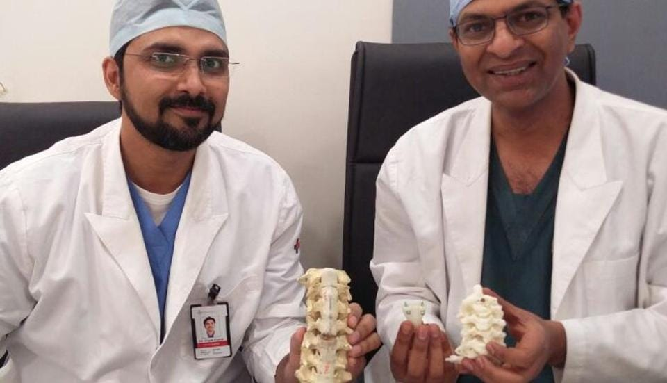 (From Left) Dr Gopal Kumar, consultant, head and  neck onco-surgeon, and Dr V Anand Naik, senior consultant, spine surgery bone and  joint, Medanta-The Medicity, Gurgaon, hold up a 3D-printed titanium vertebrae