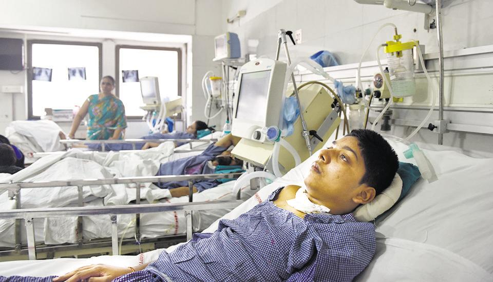 Rohit Kumar, 14, has been admitted to the AIIMS neurosurgery ward for over a year because he requires ventilator support which his family cannot afford at home.